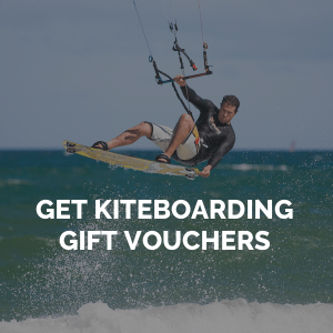 Image of Kitesurfer wave jumping. Promoting gift vouchers for Kitesurfing Kiteboarding Lessons School Tuition West Sussex Wittering Bracklesham Close to London