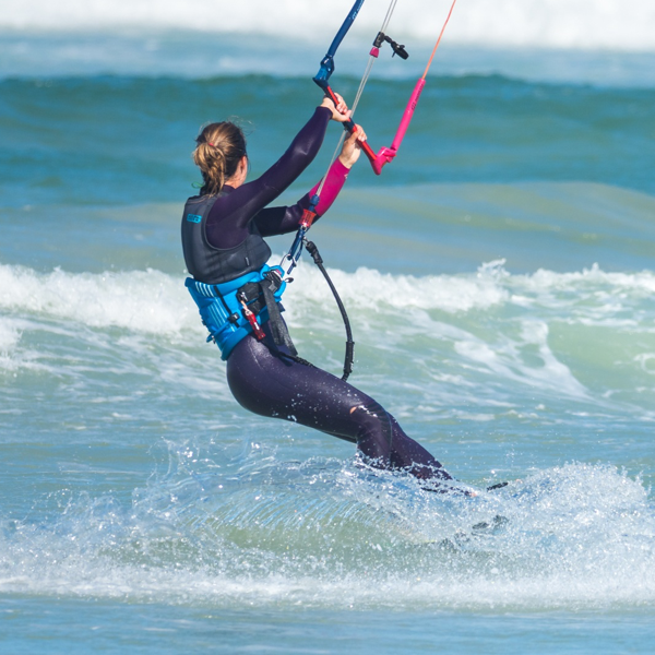 Image of woman Kitesurfer for Kitesurfing Kiteboarding Lessons School Tuition West Sussex Wittering Bracklesham Close to London